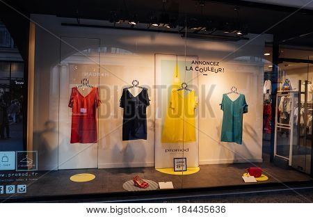 STRASBOURG, FRANCE - APR 27, 2017: Promod fashion clothing store with multi colored dresses in the vitrines illuminated by spotlight