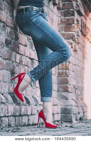 Girl on the street in red patent leather shoes