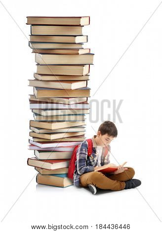 Adventure story and fairy tale. Boy with books and magic glowing on white background
