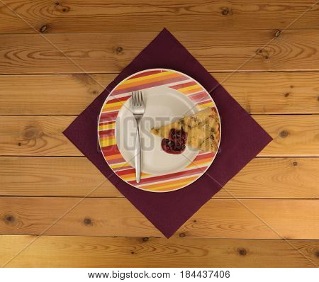 Cowberry jam pie on a plate on a table