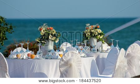 Decorated Wedding Table at the Seaside. Table set for an event party or wedding reception.