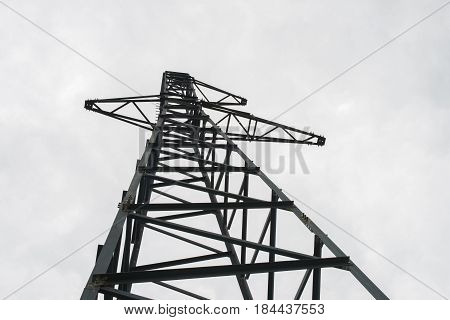 Abandoned high voltage mast without wires. Russia.