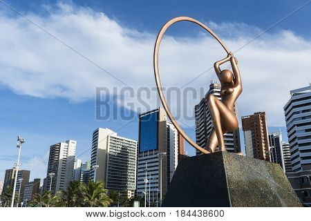 Fortaleza, Ceara, Brazil - Circa May 2016: Iracema Statue in Praia de Iracema beach with Fortaleza city skyline behind