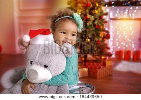 Little mixed African Girl at Home with Christmas Interior