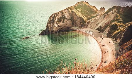 Durdle Doora very popular beach of sand and fine pebbles on the Jurassic Coast Dorset England United Kingdom