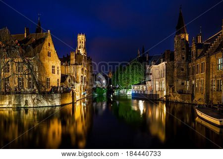 Night view of famous Bruges city view, Belgium, nightshot of Brugge canals, houses on Belfry canal