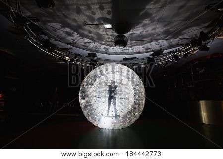 Zobing Balloon against backlight. Abstract picture. Dark backdrop