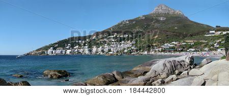 FROM CLIFTON, CAPE TOWN SOUTH AFRICA, LANDSCAPE, WITH BOULDERS IN THE FORE GROUND AND  A MOUNTAIN IN THE BACK GROUND 21mju