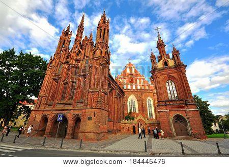 VILNIUS LUTHIANIA - AUGUST 11: Facade of Bernardine gothic church in Vilnius Lithuania on August 11 2012.