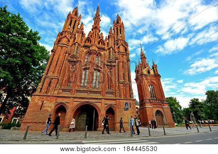 VILNIUS LUTHIANIA - AUGUST 11: People at the Church of St. Francis and St. Bernard in Vilnius on August 11 2012.