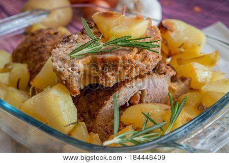 Meatloaf with speck, cheese and baked potato