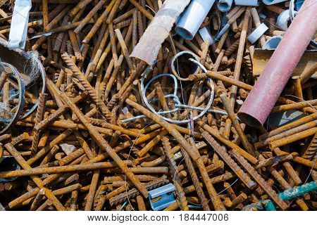 Construction site. Remains of building materials. Rusted fittings, plastic pipes, pieces of metal.
