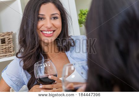 Beautiful Hispanic Latina woman with perfect teeth drinking wine at home with a female friend