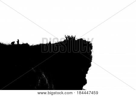 Black and white silhouette background of group tourist standing arms outstretched happy with success on peak mountain near the cliff at Phu Chi Fa Viewpoint in Chiang Rai Province Thailand