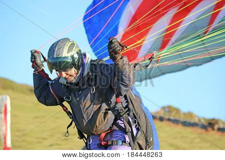 Paraglider doing a forward launch to fly