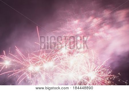Bright beautiful colorful fireworks celebration. Colored lights in the night sky celebration. New Year celebration holiday. Wedding celebration. Celebration concept