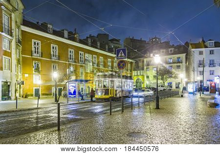 Lisbon At Night, Street, Cable Car  And Old Houses Of The Historic Quarter In Lisbon