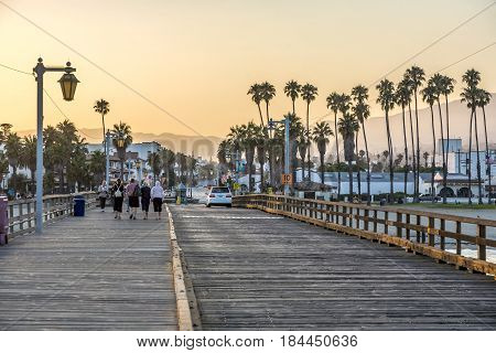 People At Scenic Old Wooden Pier In Santa Barbara In Sunset