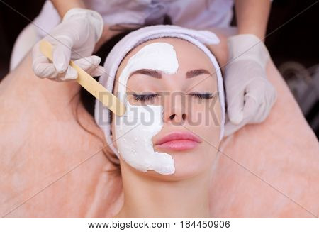 The Doctor Is A Cosmetologist For The Procedure Of Cleansing And Moisturizing The Skin, Applying A M