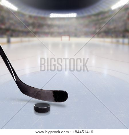 Hockey Stick And Puck On Ice Of Crowded Arena