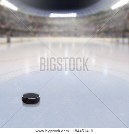 Hockey Puck On Ice Of Crowded Arena