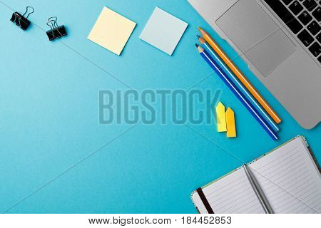 Start of Morning work office desk with computer laptop pencil Sheet paper notebook pen blue texture table Business concept background