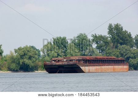 Anchored cargo barge on the Danube near by city of Novi Sad Serbia