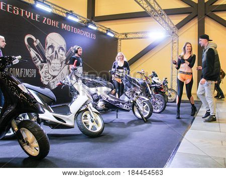 St. Petersburg Russia - 15 April, A visitor with a model,15 April, 2017. International Motor Show IMIS-2017 in Expoforurum. Visitors and participants of the annual moto-salon in St. Petersburg.