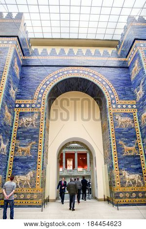 BERLIN GERMANY - APRIL 7: Tourists in front of Ishtar gate from historical town Babylon gate in Pergamon museum on April 7 2017 in Berlin