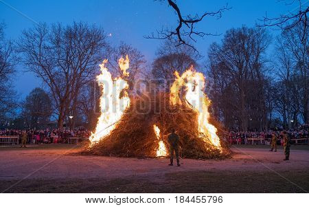 NORRKOPING, SWEDEN - APRIL 30, 2017: Traditional Swedish celebration of spring at Walpurgis night with bonfire and music at Folkparken in Norrkoping. The festival is named after Saint Walpurga.