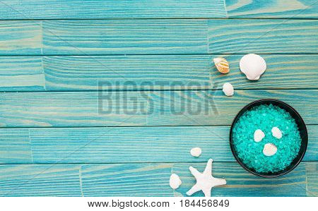 Spa Composition. Candles, Sea Shells And Stars, Flowers, Sea Salt On On Turquoise Wooden Background.