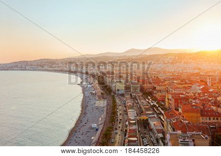 cityscape of Nice with beach and sea at sunset, French Riviera, France