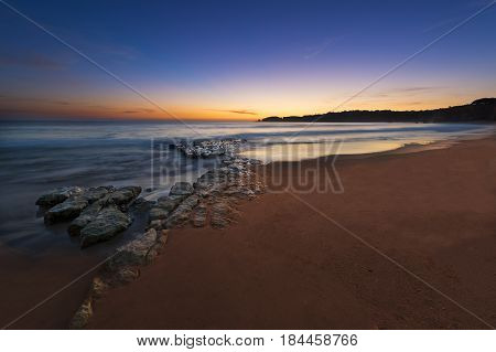 View of the Vau Beach (Praia do Vau) at sunset in Portimao Algarve Portugal; Concept for travel in Portugal and Algarve