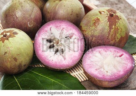 Ripe purple star apple fruit on table.