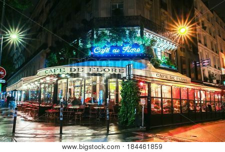 Paris France-April 30 2017: The famous cafe de Flore located at the corner of boulevard Saint Germain and rue Saint Benoit. It was once home to intellectual stars from Hemingway to Pablo Picasso.