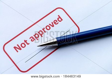 Not Approved Stamp With Pen On White Paper