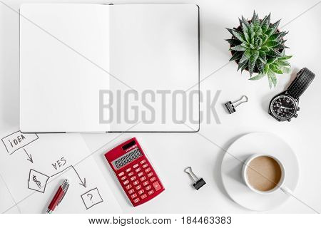 business plan development with copybook on white office desk background top view mock-up