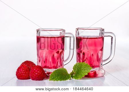 Liqueur of raspberry with fresh berries
