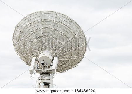 Radio telescope dish pointing at the sky