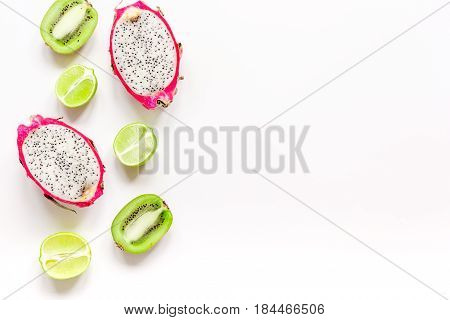 summer pattern with kiwi and pitaya on white desk background top view mock up