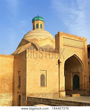 Old-time central asian building with gate dome and small turret
