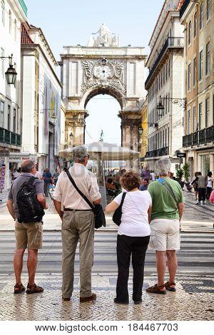 Lisbon, Portugal - May 14, 2012: Tourists near Rua Augusta arch in Lisbon