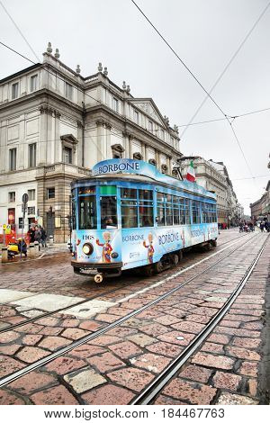 Milan, Italy - October 15, 2016: Vintage tram in front of La Scala theater in Milan