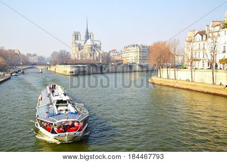 Paris, France - March 05, 2011: Seine river and  Notre Dame de Paris in spring