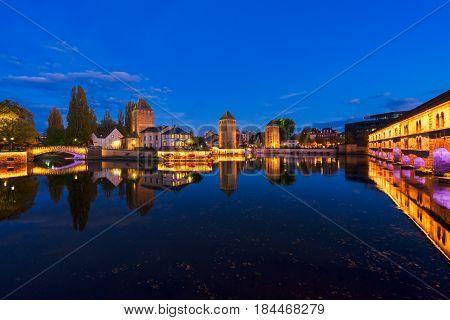 medieval bridge Ponts Couverts and barrage Vauban, night scene of Strasbourg, France