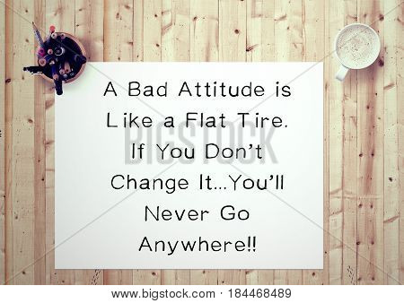Inspiring motivation quote handwritten on a notepad a bad attitude is like a flat tire, if you don't change it...you'll never go anywhere. White pad paper image.