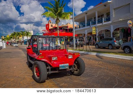 COZUMEL, MEXICO - MARCH 23, 2017: Colorful Red Jeep car, some tourist rent it to visit the most attractive places around the beautiful Cozumel, very useful for Stoned roads where convencional cars can not cross.