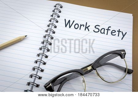 Vintage glasses old on a notebook of work with work safety words as