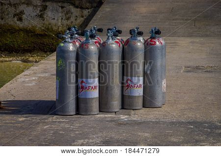 COZUMEL, MEXICO - MARCH 23, 2017: Oxygen tanks for scuba diving, that are use for tourist that rent boats to raid to visit the coral reefs and enjoy the colorful nature under the sea.