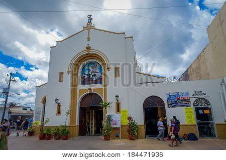 COZUMEL, MEXICO - MARCH 23, 2017: San Miguel Church is full of turist that made lose their original atractive, procession of people pass through the city on April 8, during Easter Mass celebrations.